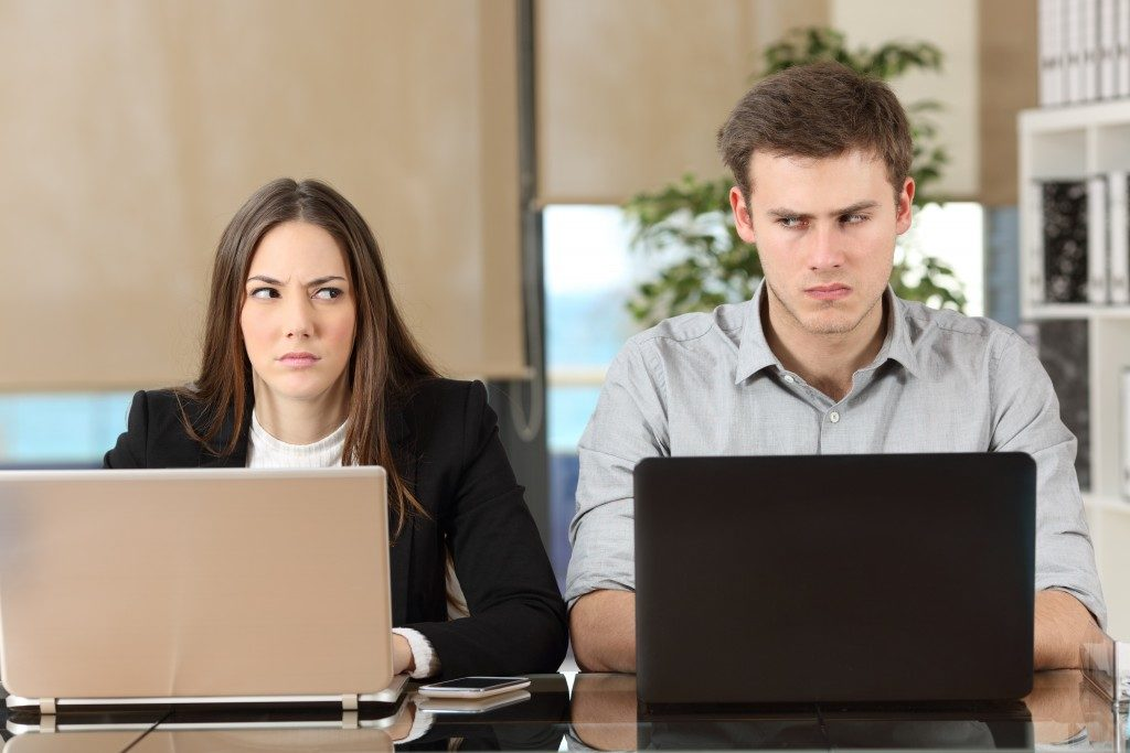 workmates annoyed with each other