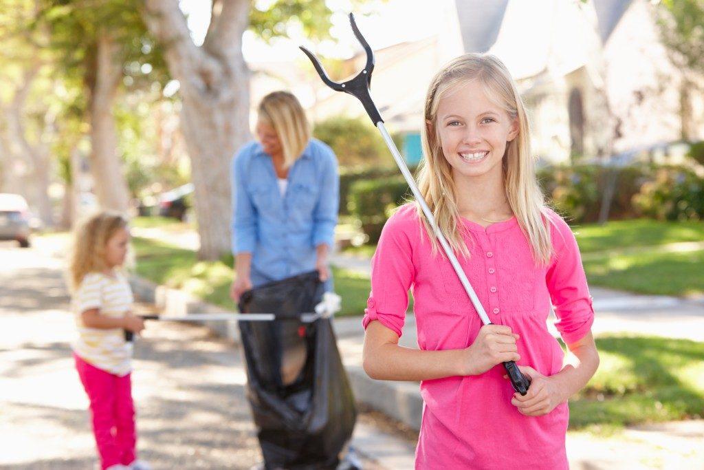 Children helping clean house