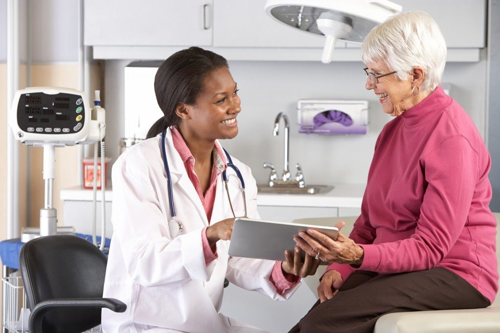 Elderly woman seeing a doctor