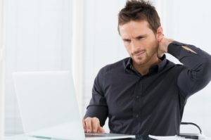 man feeling stressed at work