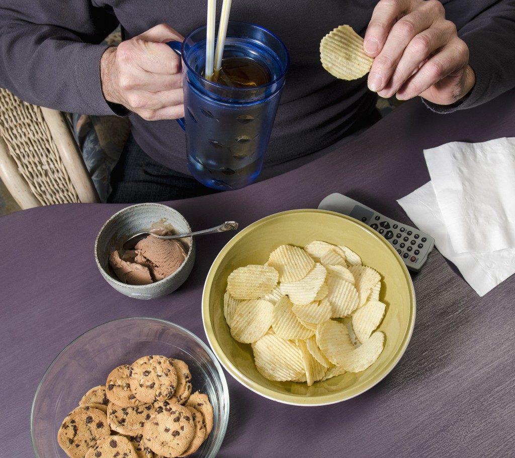 Man binge-eating junk food