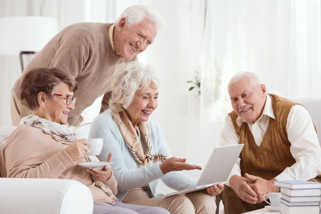 ImageElderly people using computer