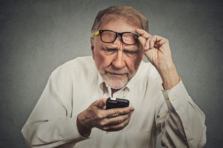 old man looking at the phone