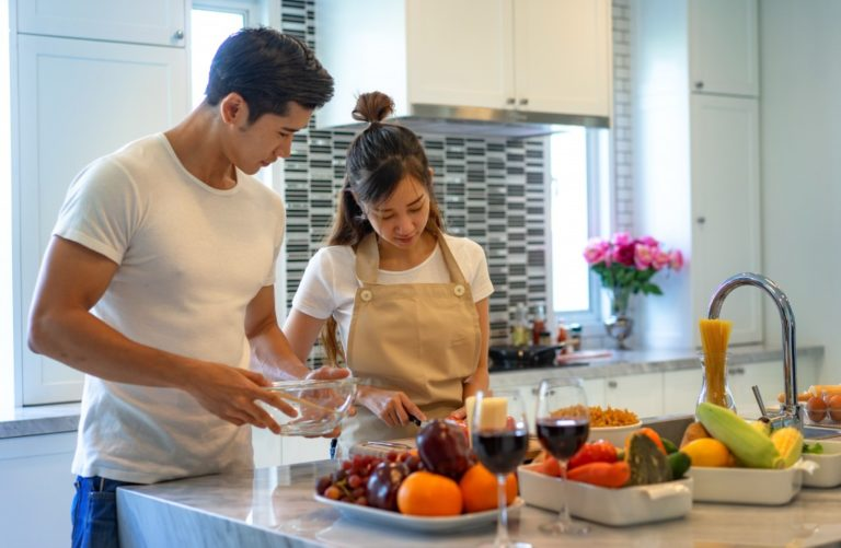couple preparing food in the kitchen