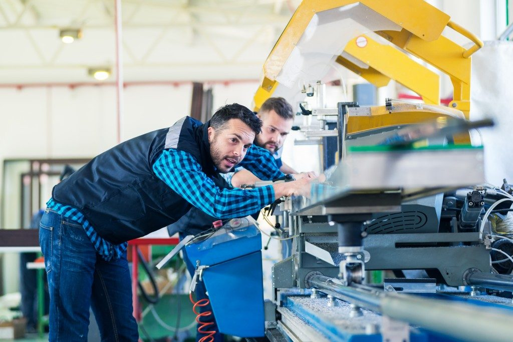 men working in a manufacturing industry