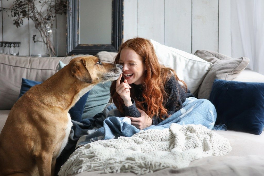 woman spending time with her dog