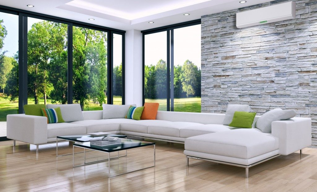 bright living room with AC unit