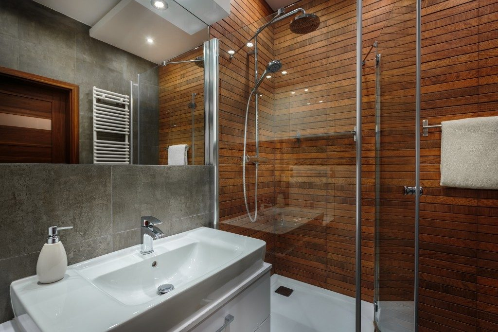 modern bathroom with wood and grey tiles