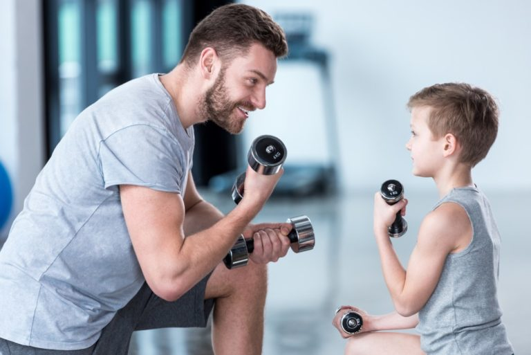 father and son exercising