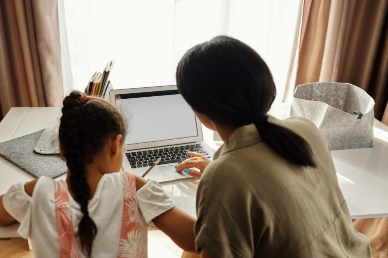 kid studying with parent