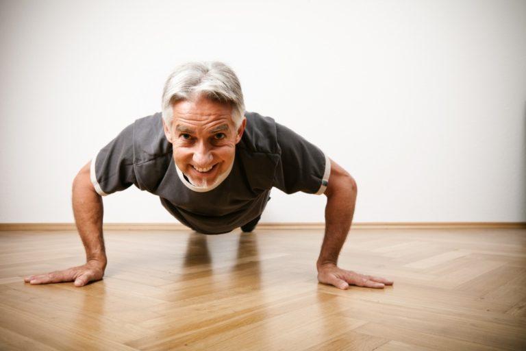 senior doing push ups