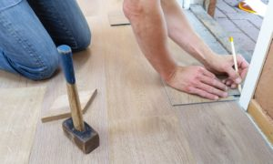 man measuring flooring