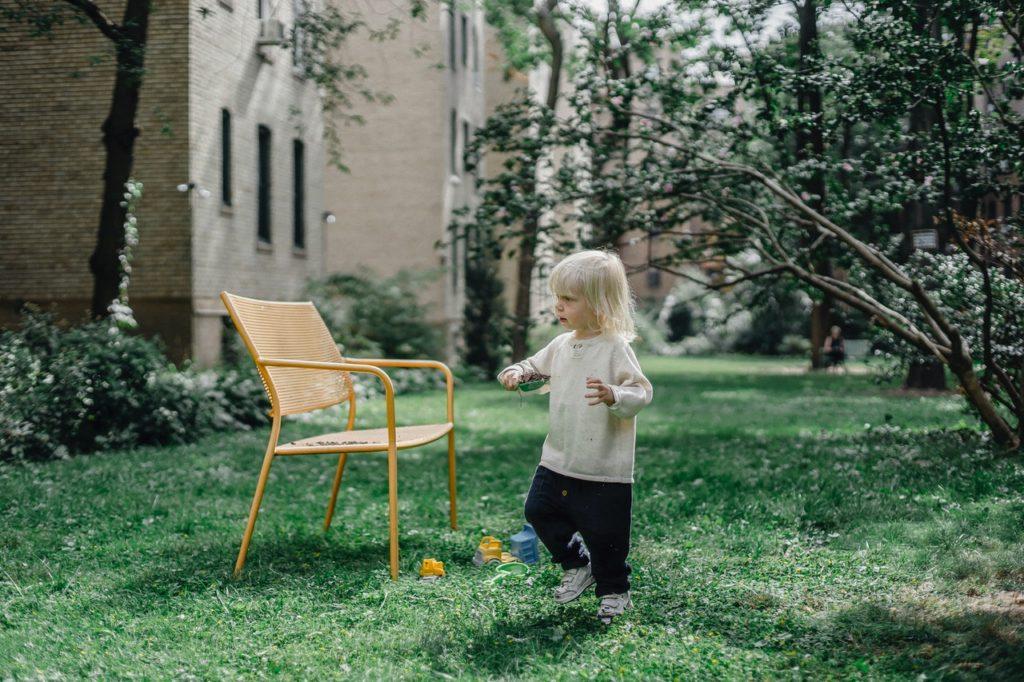 child and yard