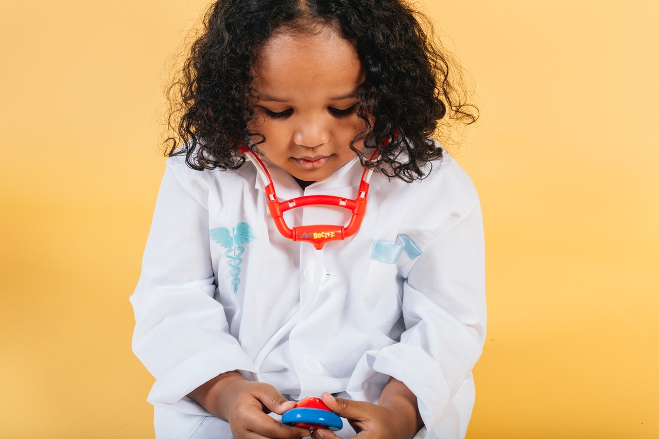 child with toy stethoscope