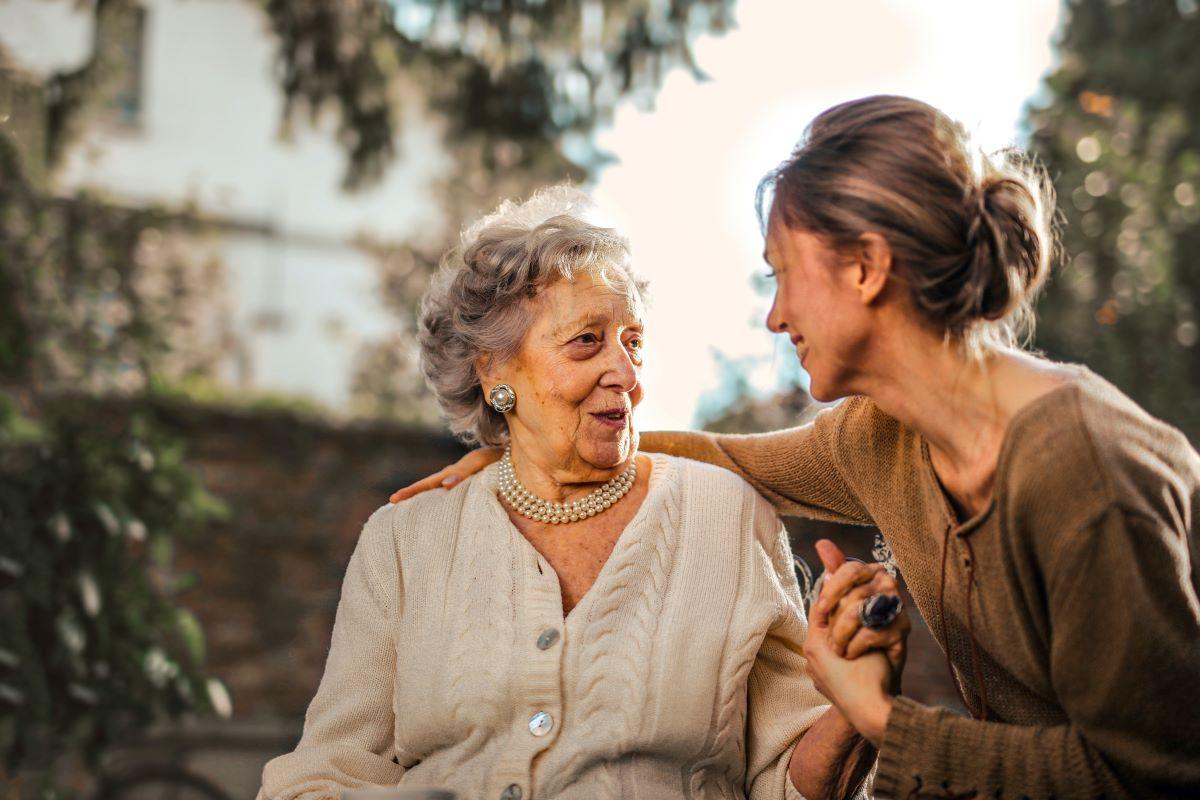 woman talking to elder