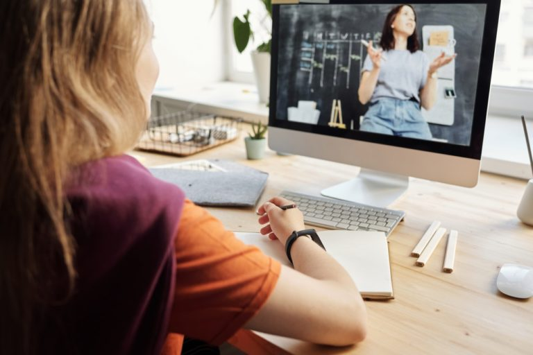 young girl attending online schooling