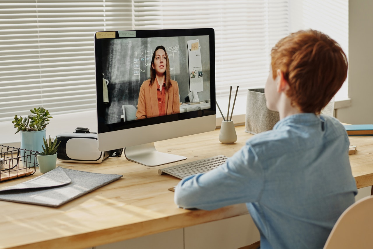 young man attending remote learning online schooling
