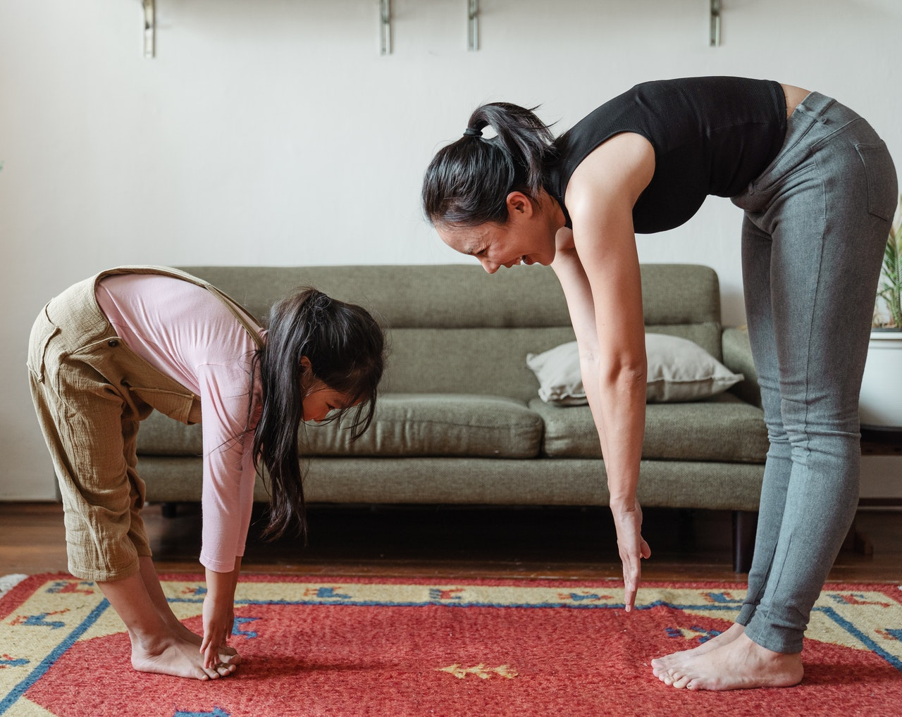 mother and daughter doing some stretching