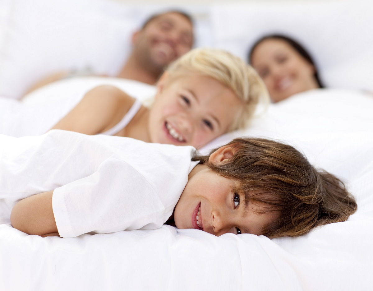 parents and kids in bed