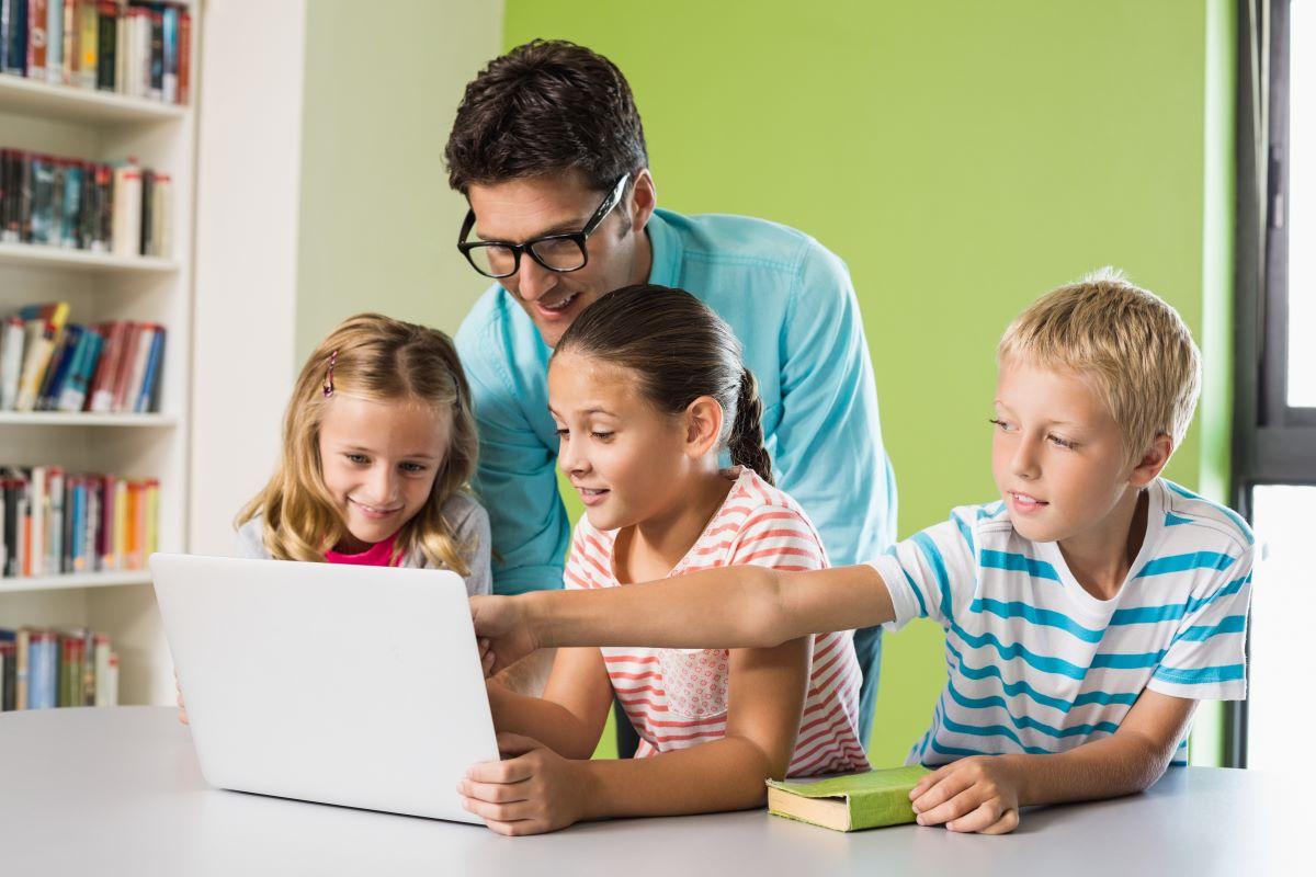 man teaching kids tablet