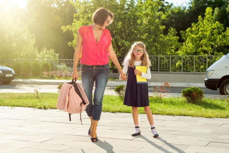 parent accompanying child to school