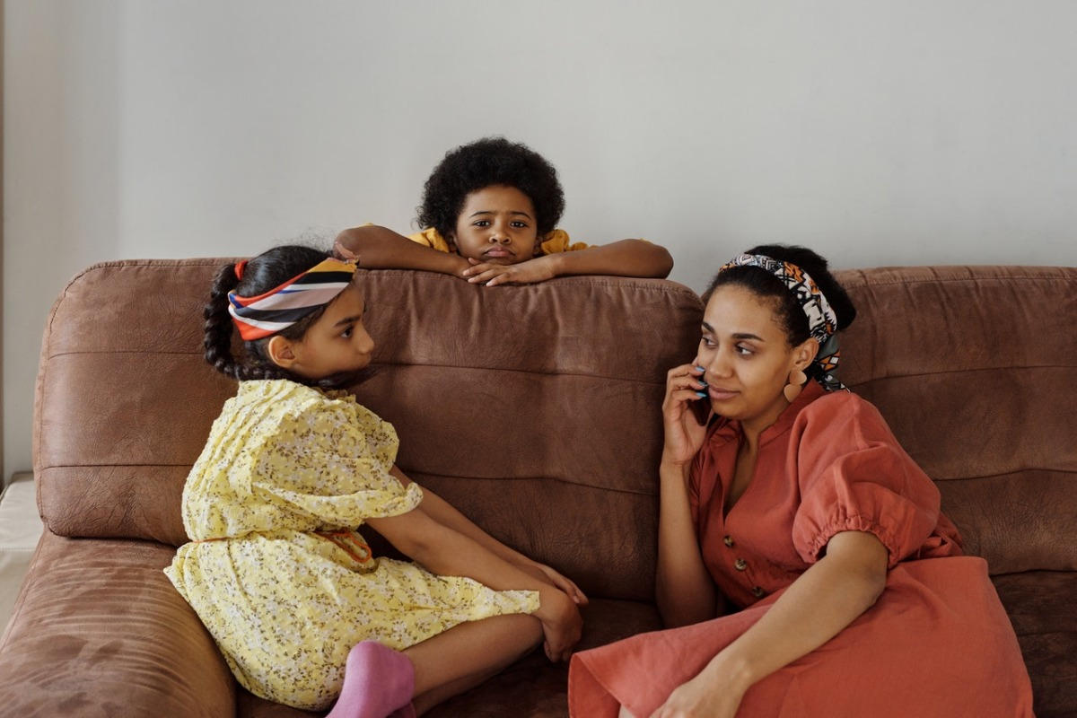 woman talking with her children