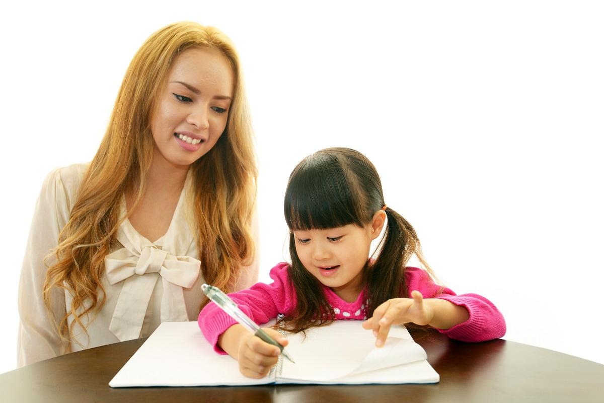 mother teaching child