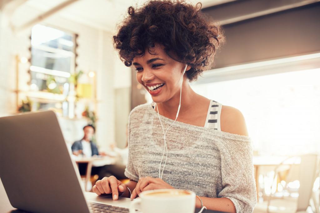 woman happy on laptop